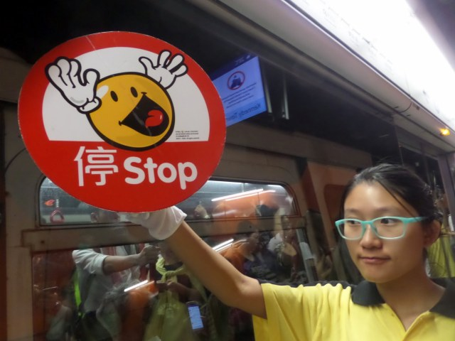 Rush hour stop sign on the Hong Kong MTR