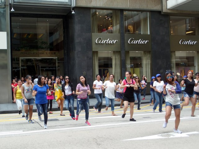 Maids dancing on day off in Hong Kong