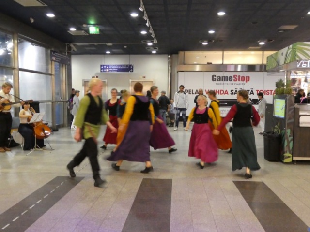 Folk dancing in Kamppi Bus Station Helsinki