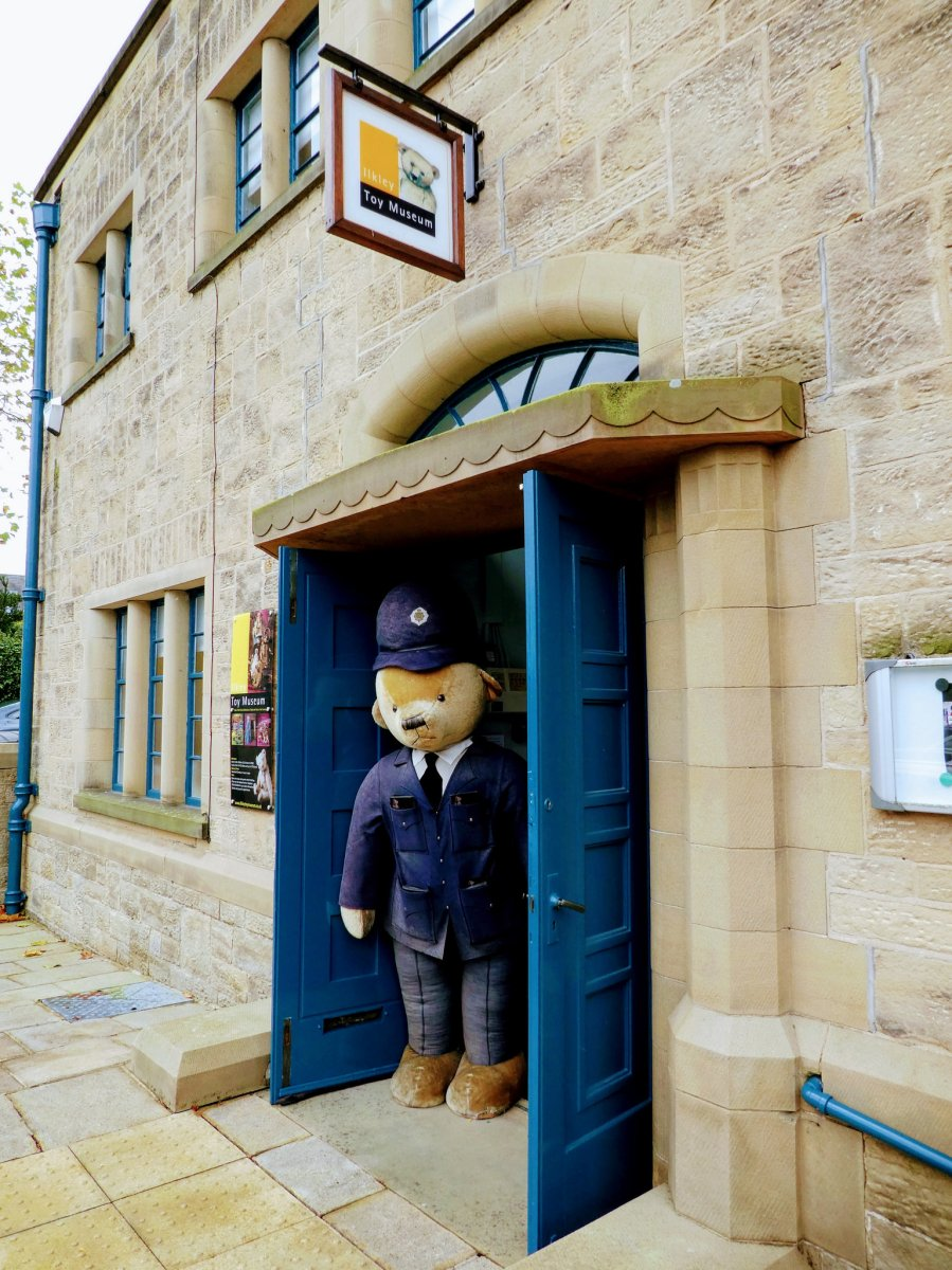 Entrance to Ilkley Toy Museum with police bear