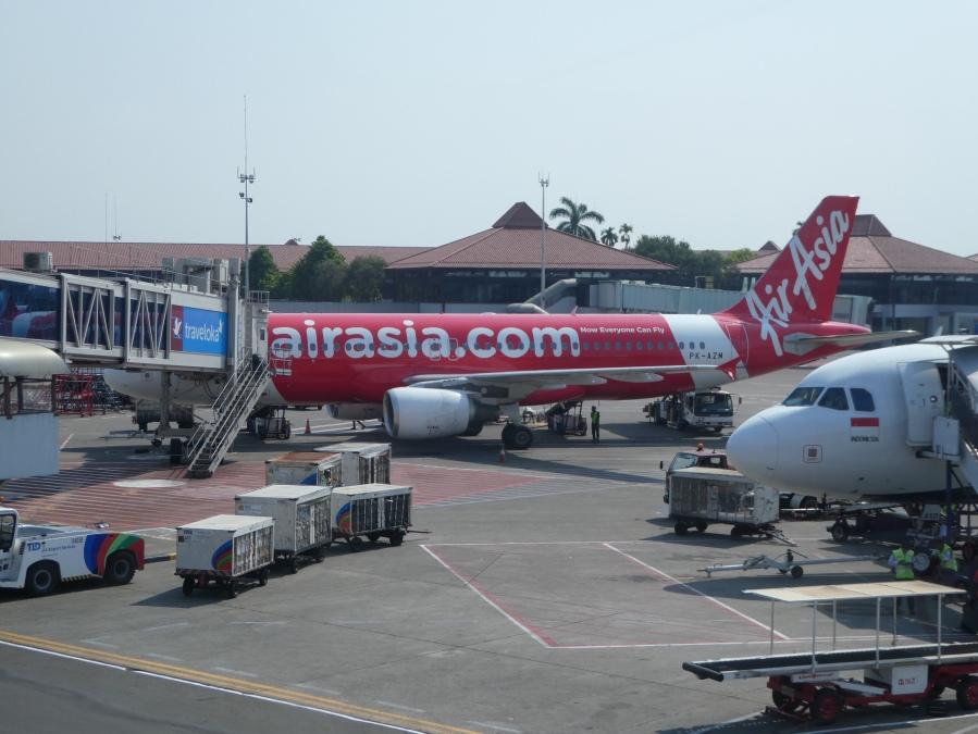 An Air Asia A320 airplane at the gate